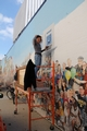 Marianne Kuhn working on the mural